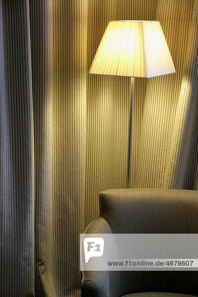 Indoor decoration curtains armchair and reading lamp in grey Indoor decoration curtains armchair and reading lamp in grey