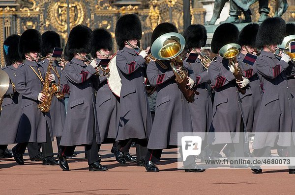 Marching band at the Changing of the Guard ceremony outside Buckingham Palace in London England