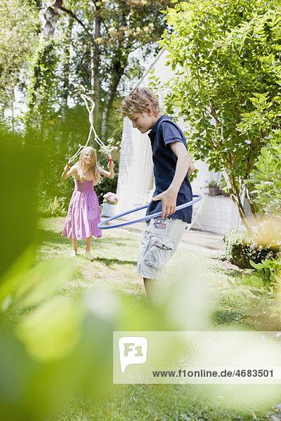 Two kids doing sport in a garden