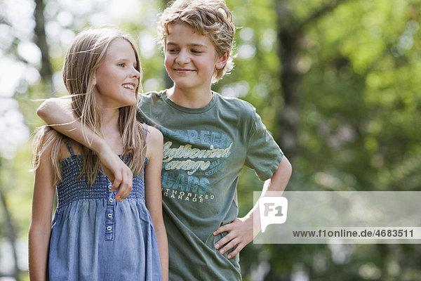 Girl and boy in garden