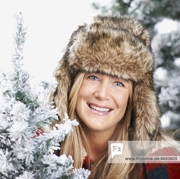 Woman with a faux-fur hat  smiling