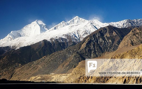 view of Jomson village and Dhampus Peak in the Annapurna region of Nepal