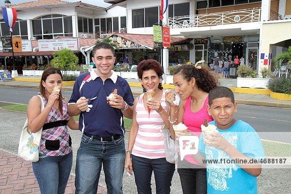 Panama  Panama City  Amador Causeway  Calzada de Amador  Bahia de Panama  Panama Canal  Isla Perico  ice cream  dessert  Hispanic  woman  man  boy  mother  son  daughter  couple  family