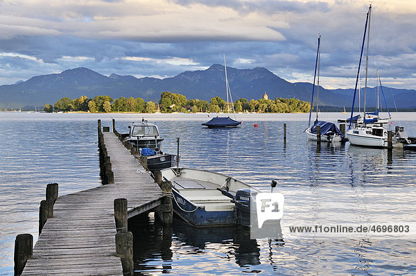 Jetty on Lake Chiemsee with a view towards Fraueninsel island  Gstadt  Chiemgau  Upper Bavaria  Bavaria  Germany  Europe