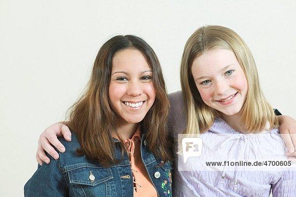 Studio portrait of two teenage friends.