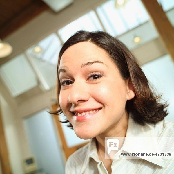 Young woman smiling in an office.