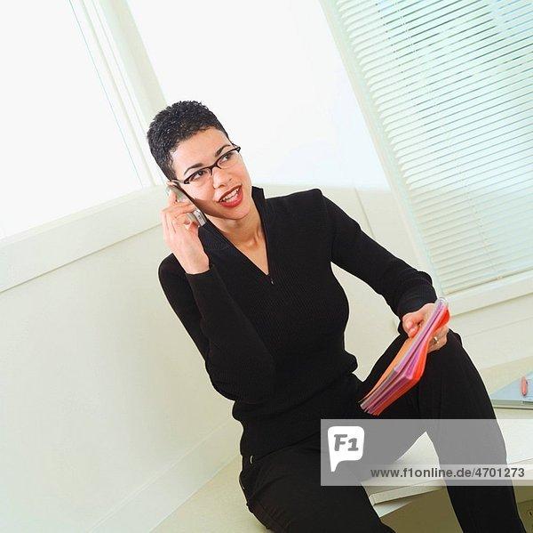 Office portrait of a woman talking on the phone.