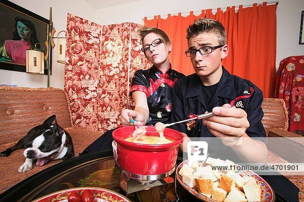 Couple at home having fondue