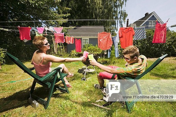 Couple toasting in back yard