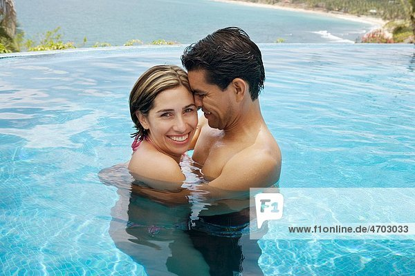Vacationing couple in swimming pool