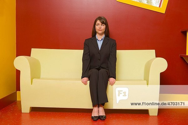Nervous businesswoman waiting in colorful room