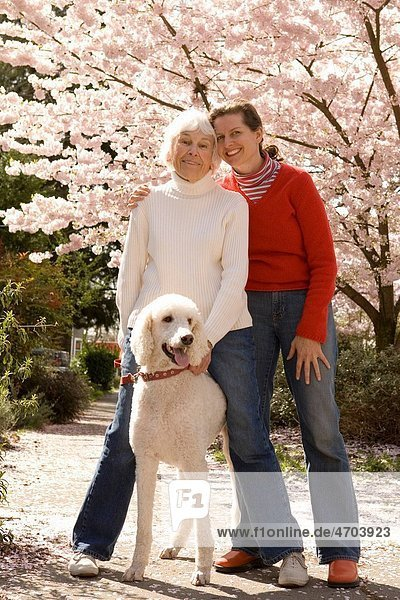 Portrait of mother with grown daughter and dog