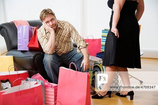 Woman trying on new clothes for bored husband