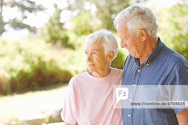 Senior man smiling at wife
