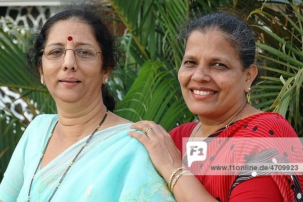 South Asian Indian two lady friends smiling MR 687G 468