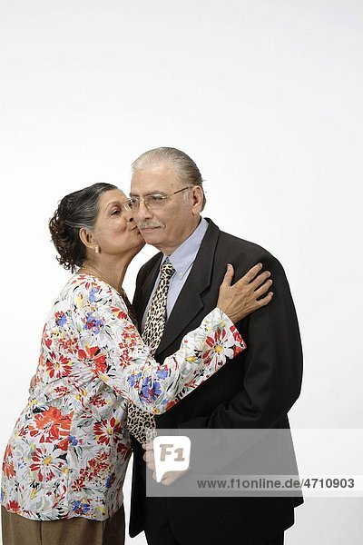 Old couple   old woman kissing old man cheek MR 703B and 703A