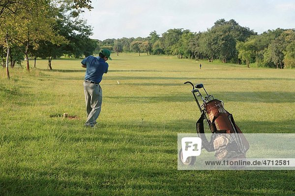 People playing golf at golf course MR 372