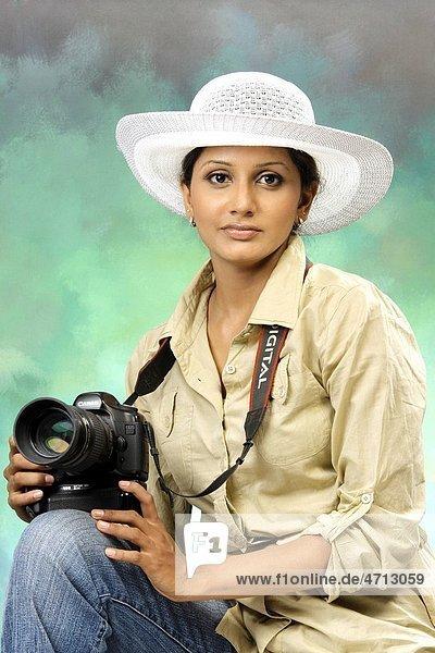 Female photographer with digital camera MR 738