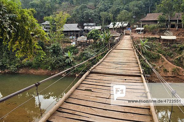 Suspension bridge leading to a village  Mai Chau valley  Northern Vietnam  Vietnam  Asia