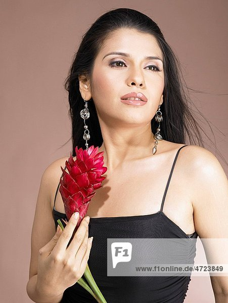 South Asian Indian woman holding red ginger flower MR 702