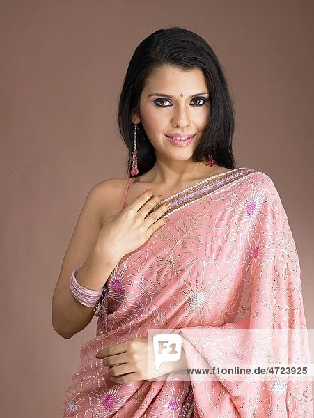 South Asian Indian woman smiling and standing in stylish pose MR 702