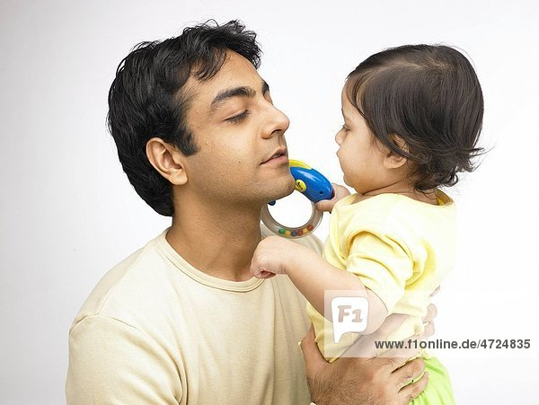Indian father and baby girl looking at each other MR702O 702A