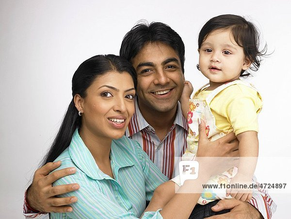 Indian parent with baby girl close to each other MR702O 702A 702L