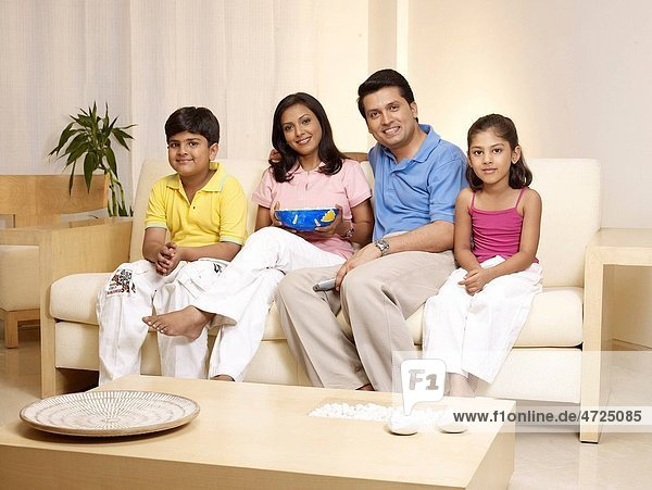 Children with parents looking at camera sitting in house MR702R MR702S MR702T MR702U