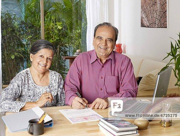 Old couple preparing legal document MR702T 702S