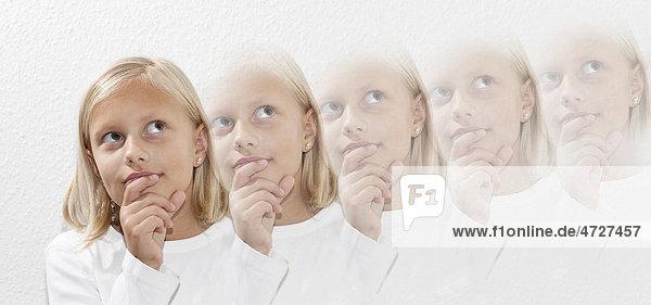 Achtjähriges Mädchen denkt nach
