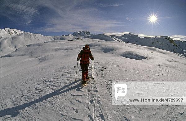 Snowshoe walker on Sennes Plateau in front of Kleine Gaisl mountain  Fanes-Sennes-Prags Nature Park  Dolomites  Italy  Europe