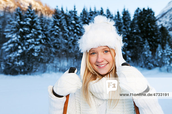 Portrait of teenage girl in white winter clothing