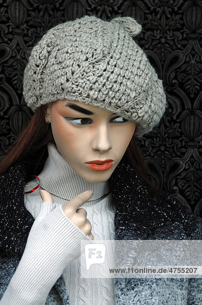 Female mannequin wearing a knitted cap in a fashion store  Erlangen  Middle Franconia  Bavaria  Germany  Europe