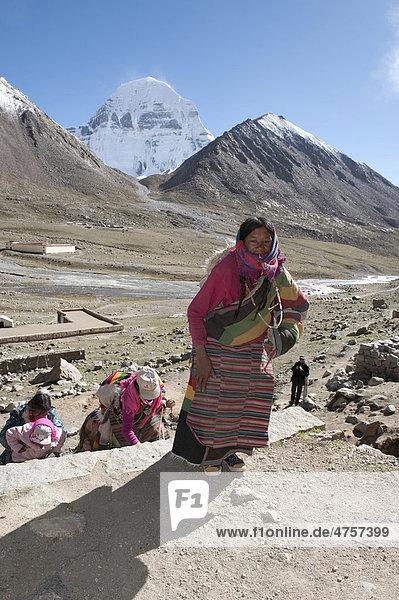 Tibetan Buddhism  religious Tibetan woman  snow-capped sacred Mount Kailash  Gang Rinpoche  Dira Puk Gompa monastery  pilgrimage route  Kora  Ngari  Gang-Tise Mountains  Trans-Himalaya  Himalayas  West Tibet  Tibet Autonomous Region  People's Republic of China  Asia