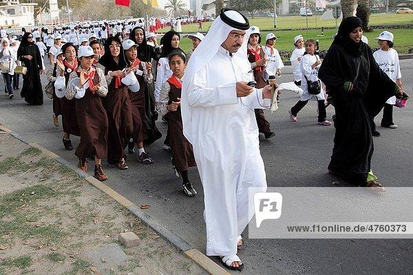 Bahrain  Manama  people in the street