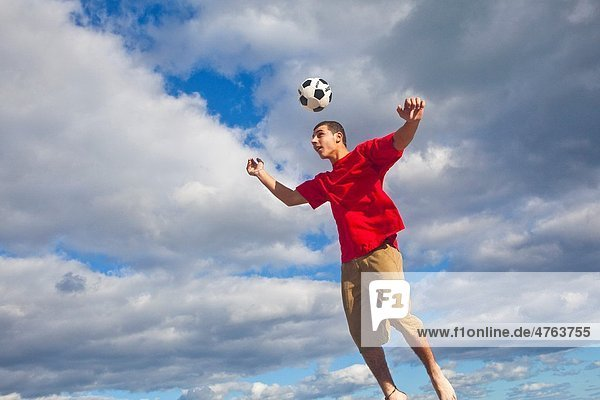 Hitting soccer ball in the air