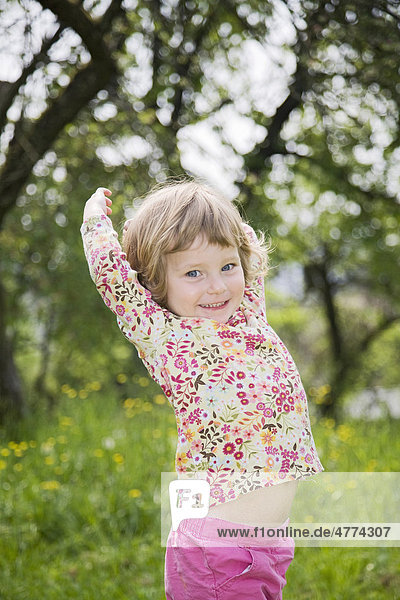 Little girl dancing with a love of life