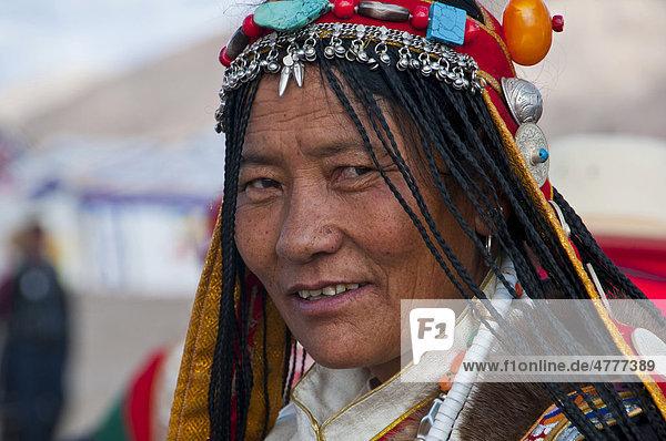 Pilgrim wearing a traditional head dress  portrait  Gerze  West Tibet  Tibet  Central Asia