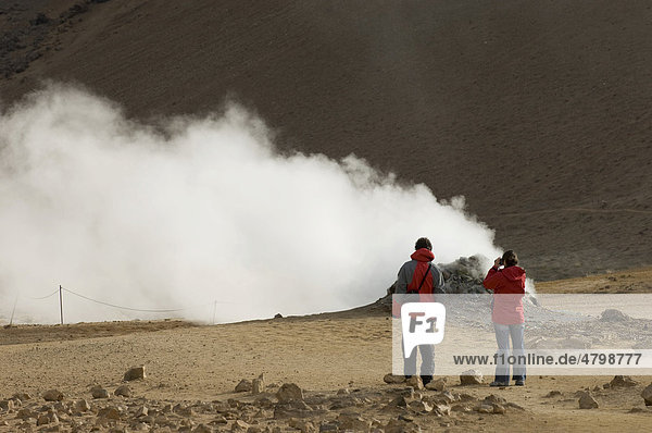 Hikers at Hverir geothermal fields at the foot of Namafjall mountain  Myvatn lake area  Iceland  Europe