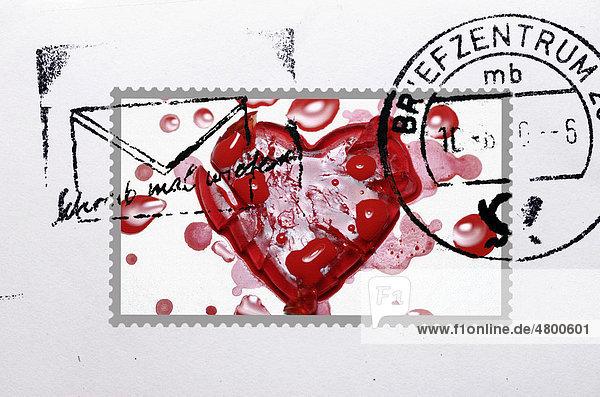 Abgestempelte Briefmarke mit gebrochenem Herzen