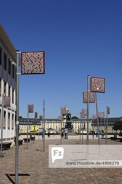 Schilder mit den Grundrechten am Platz der Grundrechte  hinten das Schloss  Karlsruhe  Baden-Württemberg  Deutschland  Europa