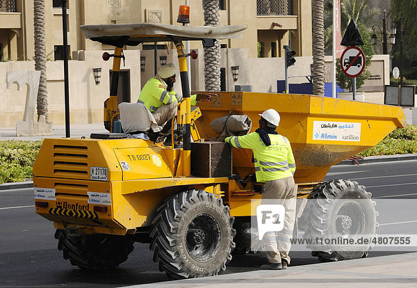 Construction workers talking with each other  Dubai  United Arab Emirates  Middle East