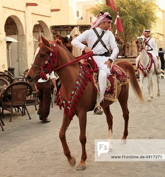 Qatar  Doha  Souq Wakif  men on horseback