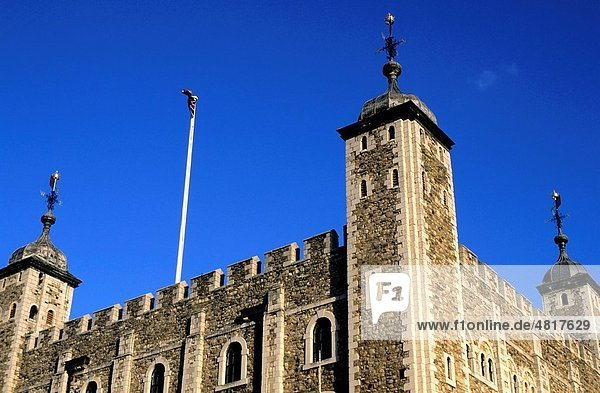 Stone facade of the Tower of London against a blue sky  London  England  UK