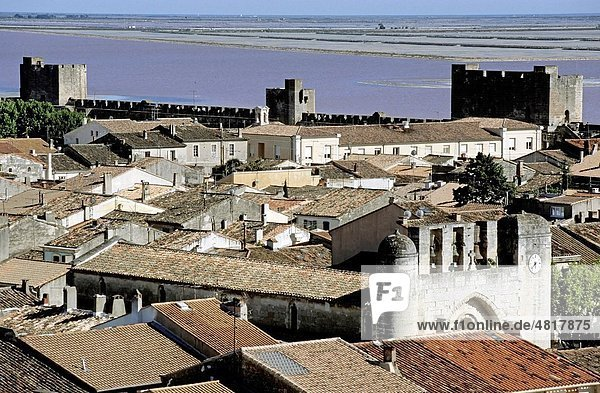 Ancient city walls and roof tops with Notre Dame des Sablons in view  Aigues-Mortes  France