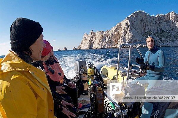 Scuba divers at sea near Maire Island  off the coast of Marseille  France
