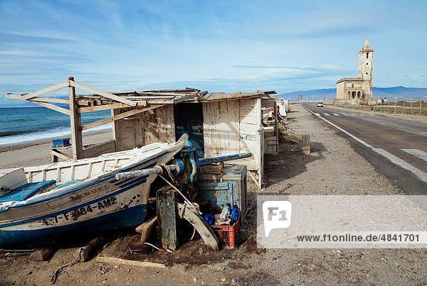 Almadraba de Monteleva  Almeria Province  Spain Fishing shed boat and old church