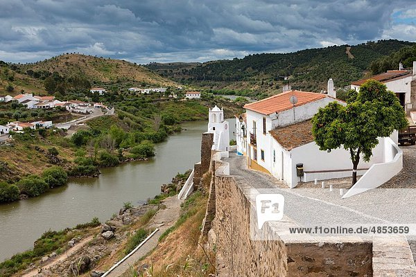 Mertola  view of city walls and River Guadian The Alentejo District Portugal Europe