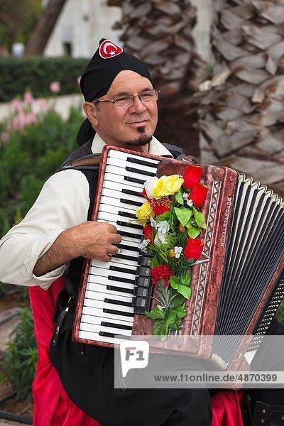 Man playing an accordian in the main square at Antalya  Turkey