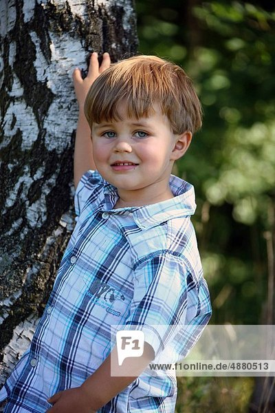 Child near tree